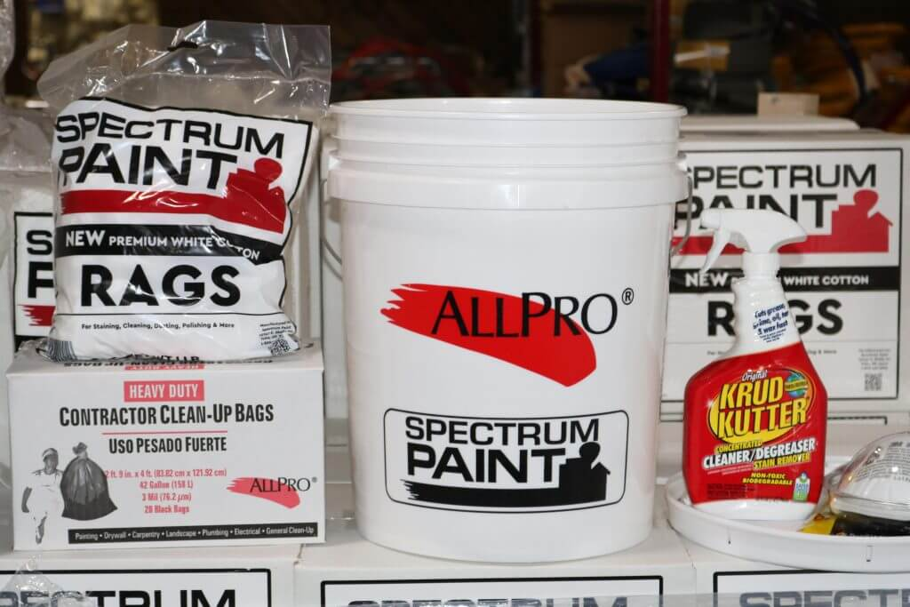 Spectrum Paint project essentials, including 1 lb. package of white rags, 1 box of heavy duty Contractor Clean-Up Bags, 5 gallon Spectrum Paint bucket, Krud Kutter 32 oz. bottle